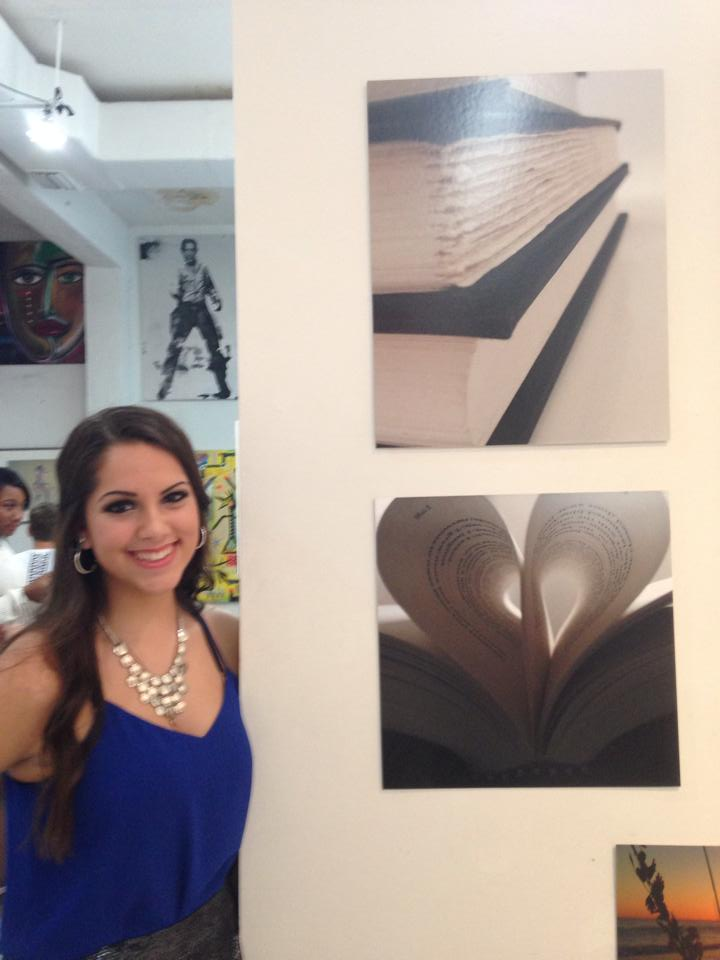 Artist Victoria Tomeo with her DIE FOR ME-themed photos.